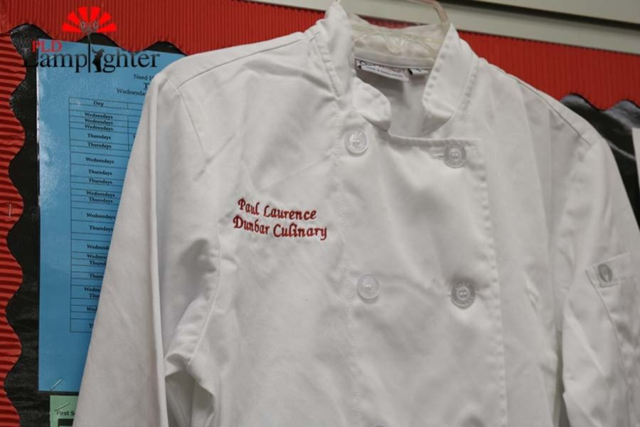 The Dunbar Culinary II students wear these chef coats when they are cooking.