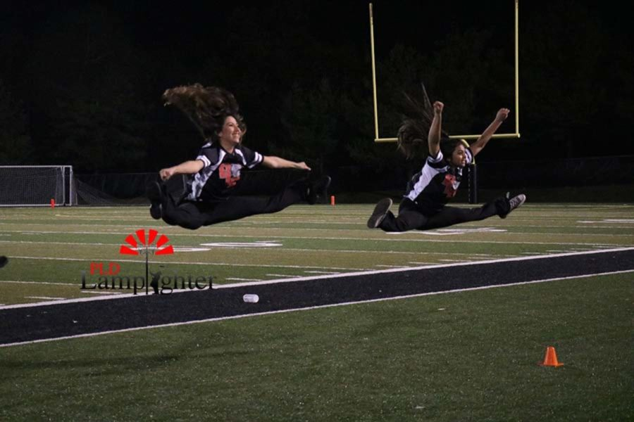 Senior dancers Andrea Alonso and Maya Anjur excite the crowd with a toe touch.