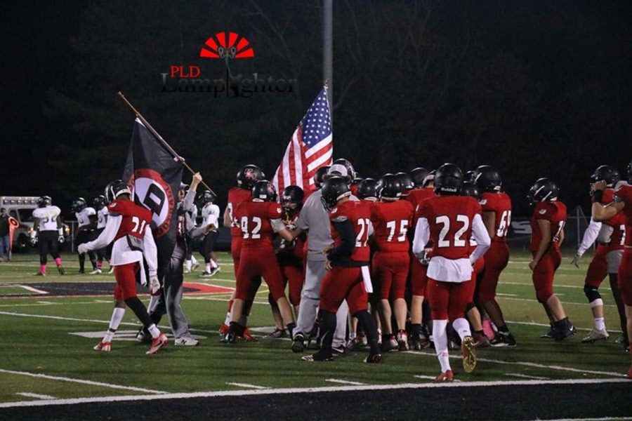 The Dunbar football team getting fired up before the game.