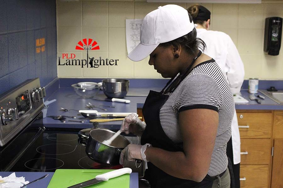 Imani Robinson prepared a glaze for the bread right before it was put in the oven to crisp up.