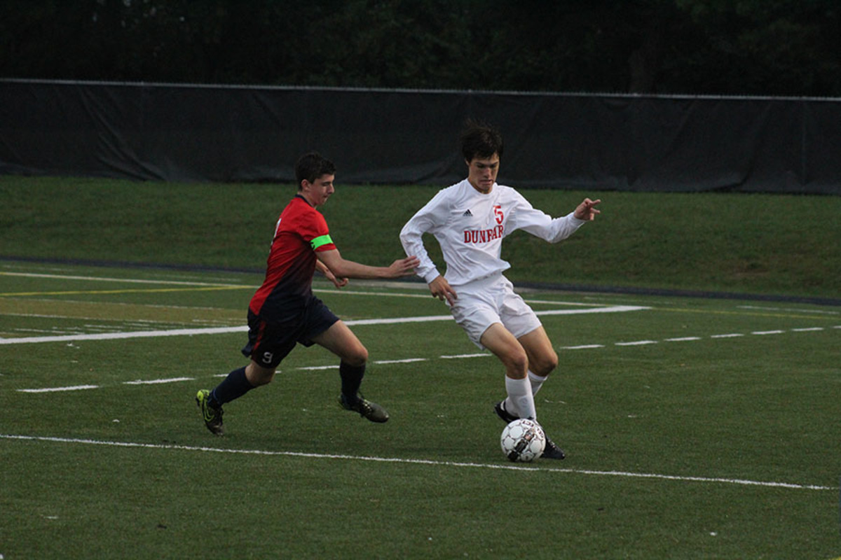 Boys' Soccer Defeats Lafayette in Rain