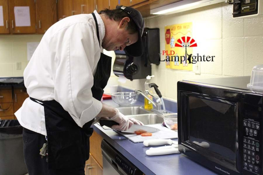 The chef from Southside Technical Center, Jim Olert, chopped tomatoes to complement the meal he prepared. He competed as a