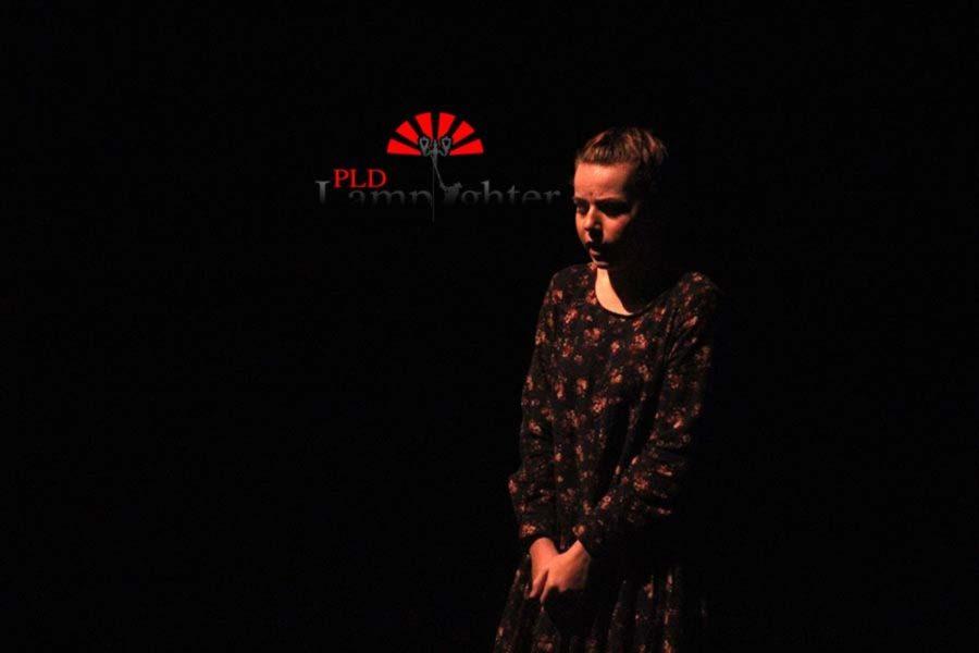 Junior Hannah Broomhall plays Annabelle in this dark scene of