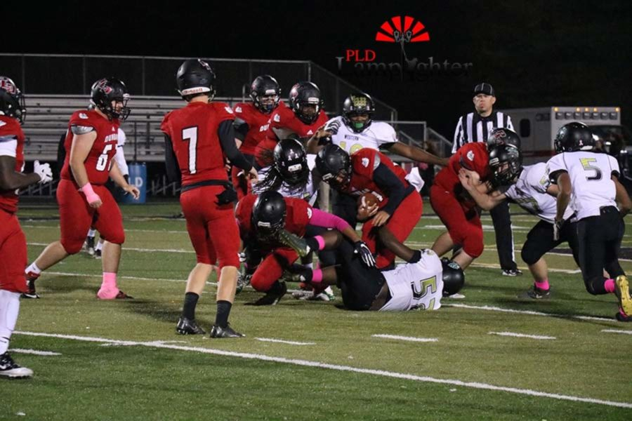Dunbar player gets trapped by opposing players.
