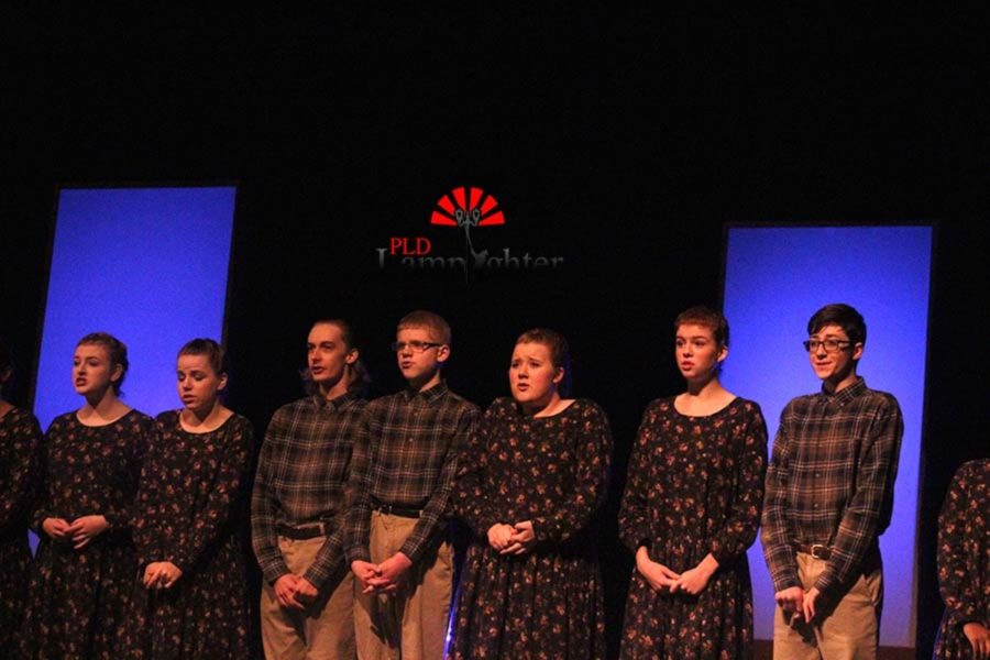 All of the characters in the play gather in a line to repeat lines in unison.