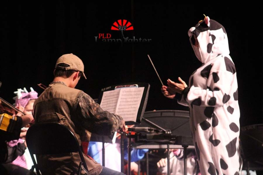 Mrs. Anna Watts directs the String Orchestra including Clay Parsons who is dressed as a cow.