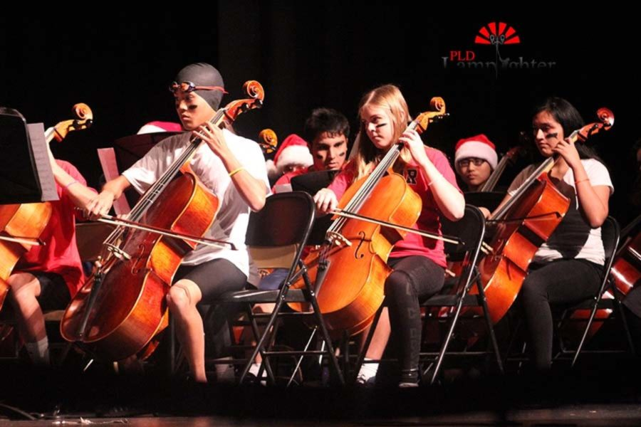 The Concert Orchestra cellists play Bold Venture while dressed up for their Halloween concert.