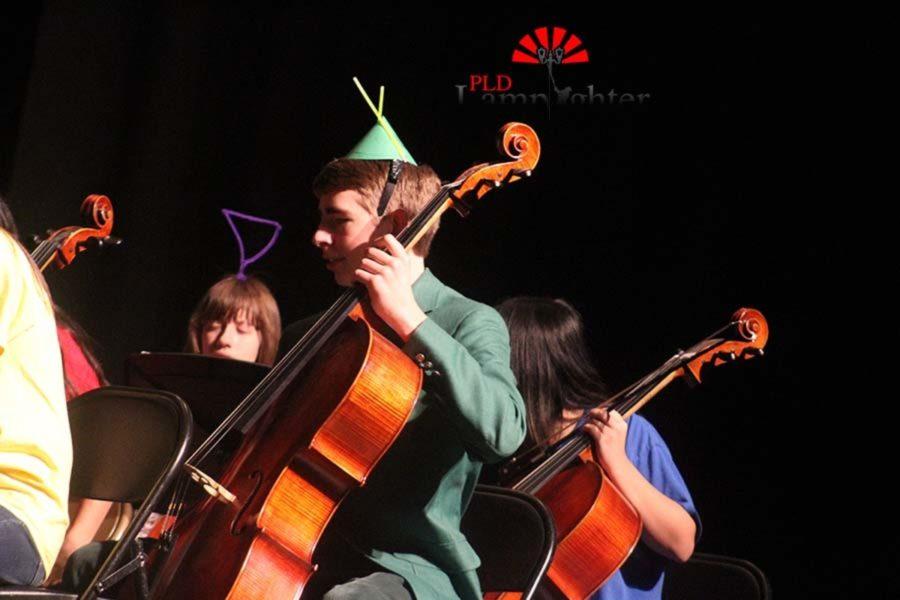 Senior James Brandewie plays the cello while dressed as a Teletubby.
