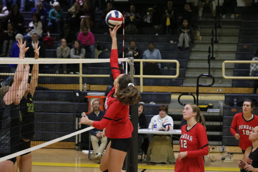 #9 Sophomore Eleanor Davis tips the ball over the net.