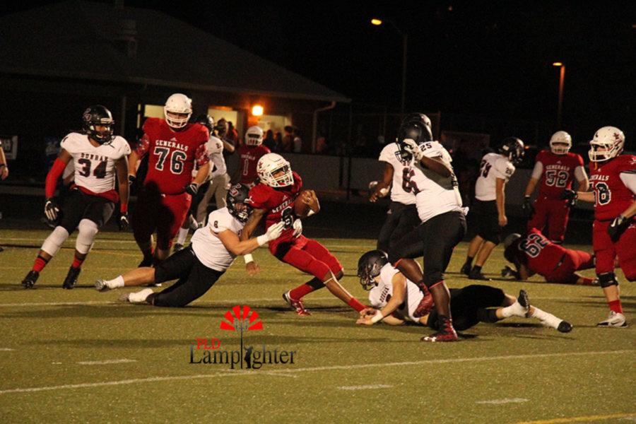 # 8 Senior Tyler Browning tackles an opposing player.