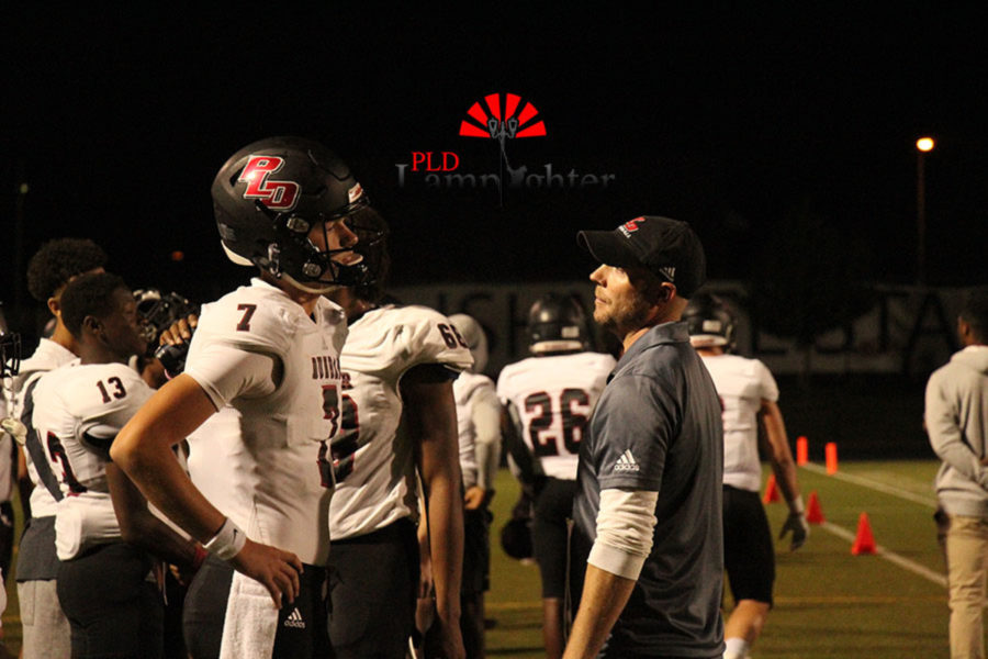 #7 Tanner Cox speaks with Coach Mullins on the sideline.