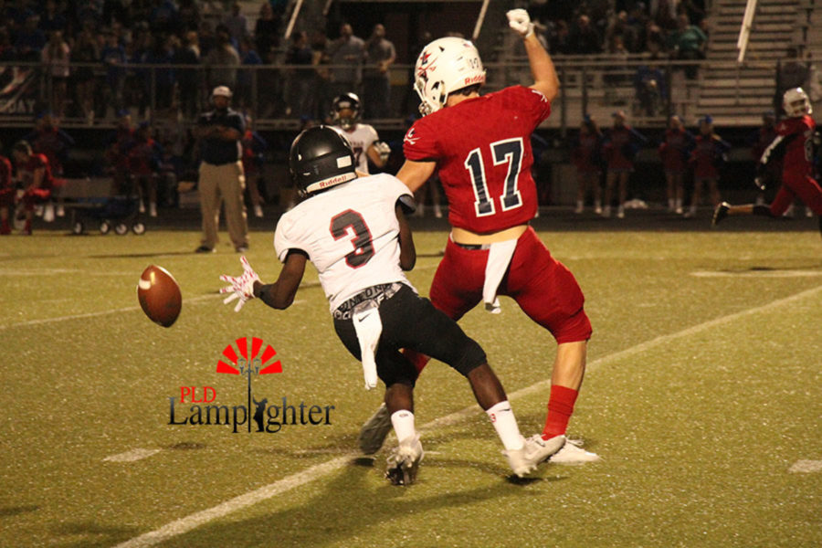 #3 Kaden Gaylord plays tight defense on the receiver.