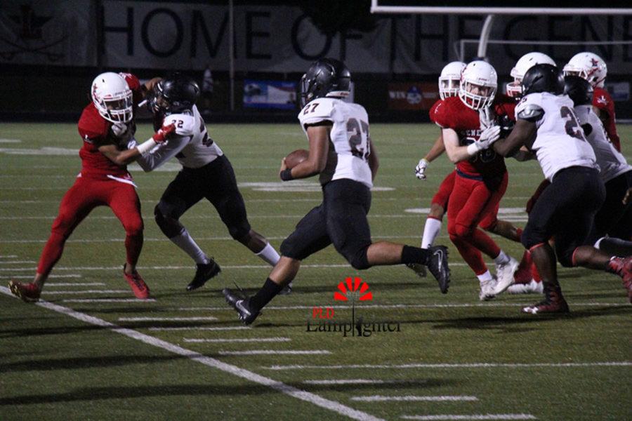 #27 Junior Alex Bard runs the ball up field.