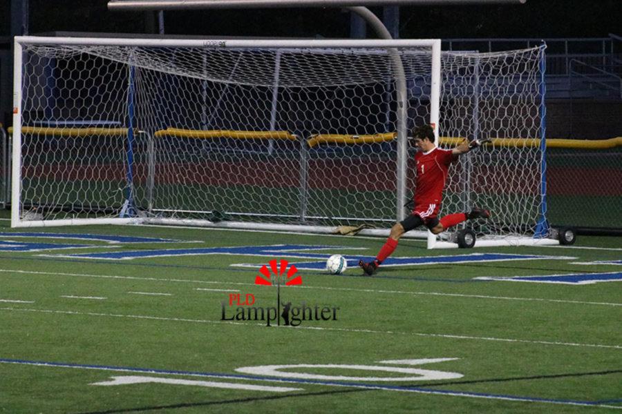 #1 Senior Josh Szydlik kicking a goal kick.