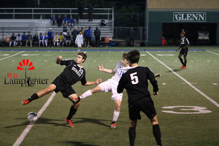 #23 Nathan Willams trying to get the ball before a defender.