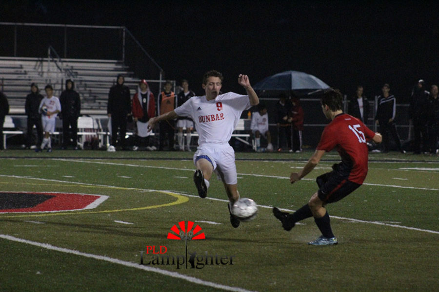 #9 Sophomore Ben Oser takes possession from the opposing player.