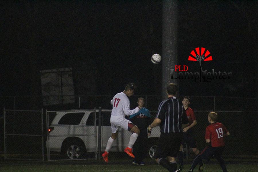 #17 Sophomore Pablo Ortiz jumps for a header.