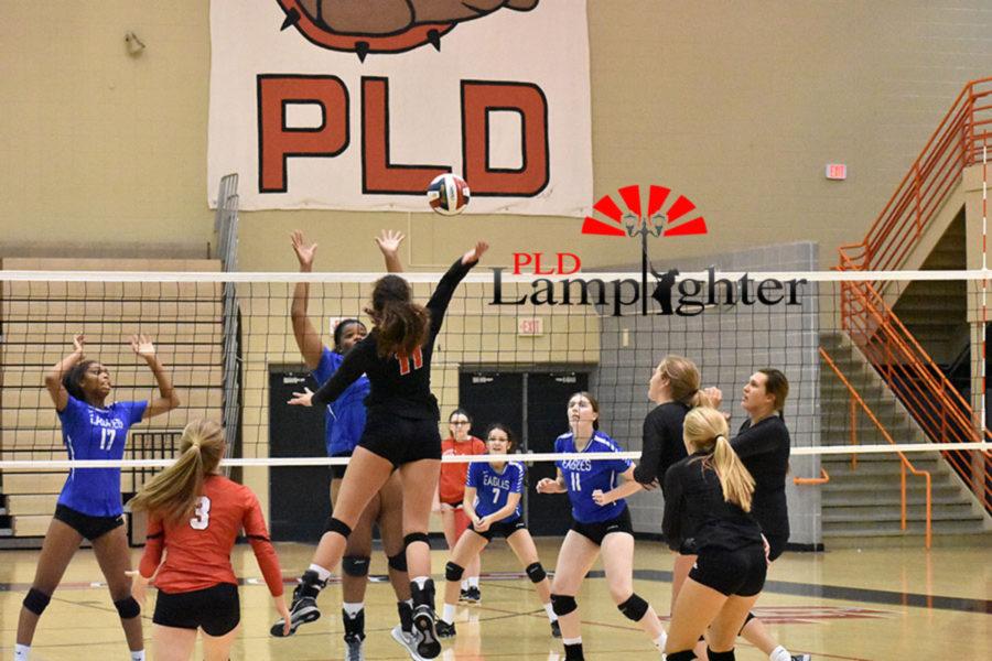 #11 Senior Savannah Dudek goes up for a big attack for Dunbar.