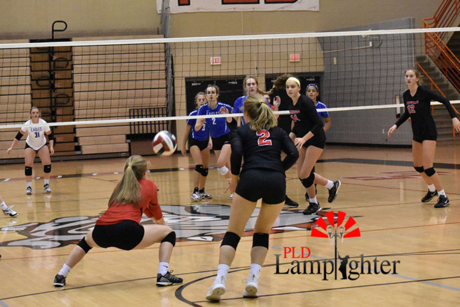 Freshman libero Caroline Cole digs a strong attack from Eastern.