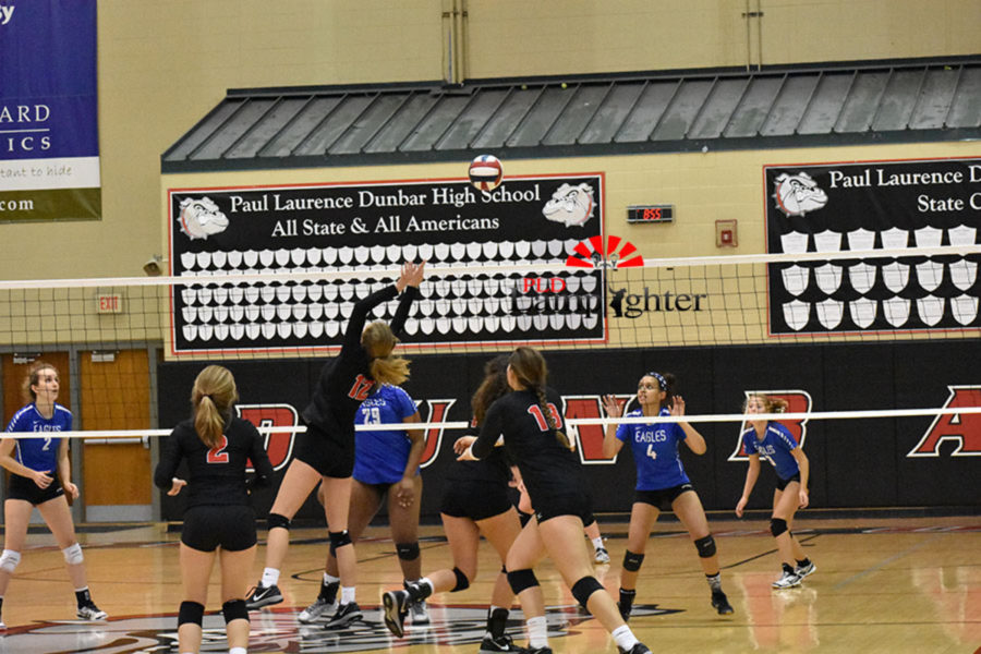 Junior Meredith Phillips sets a backwards for Peyton Gash to attack.