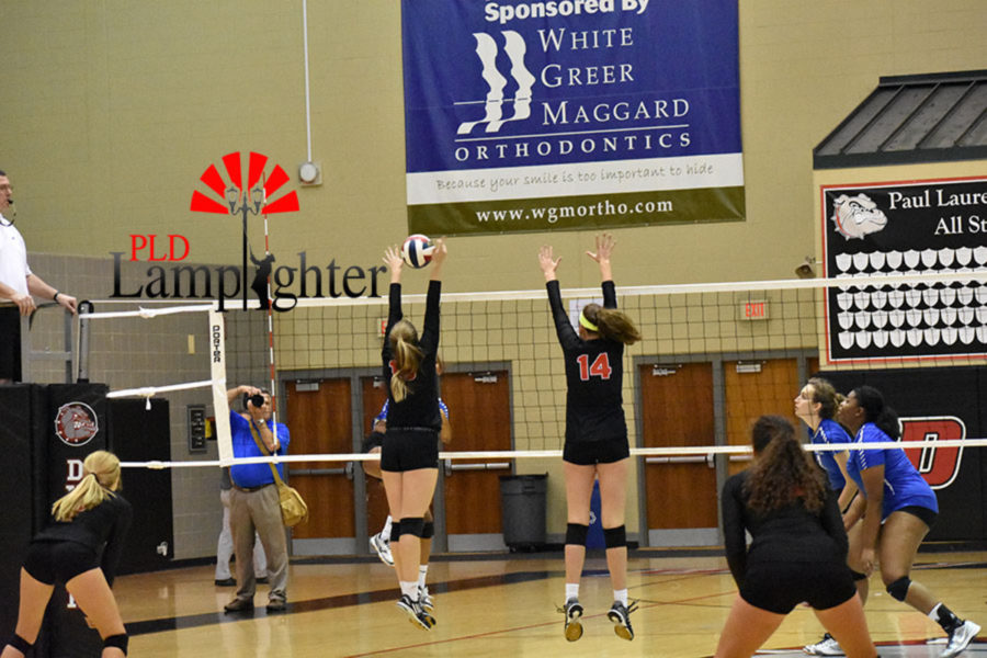 #13 Virginia Smith and #14 put up a solid block against Eastern.