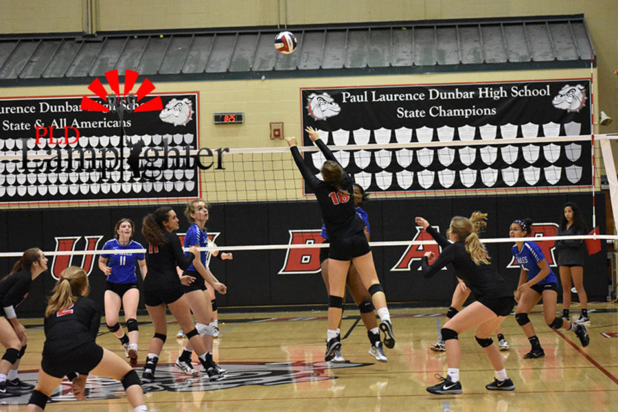 Sophomore Peyton Gash gets a block touch.