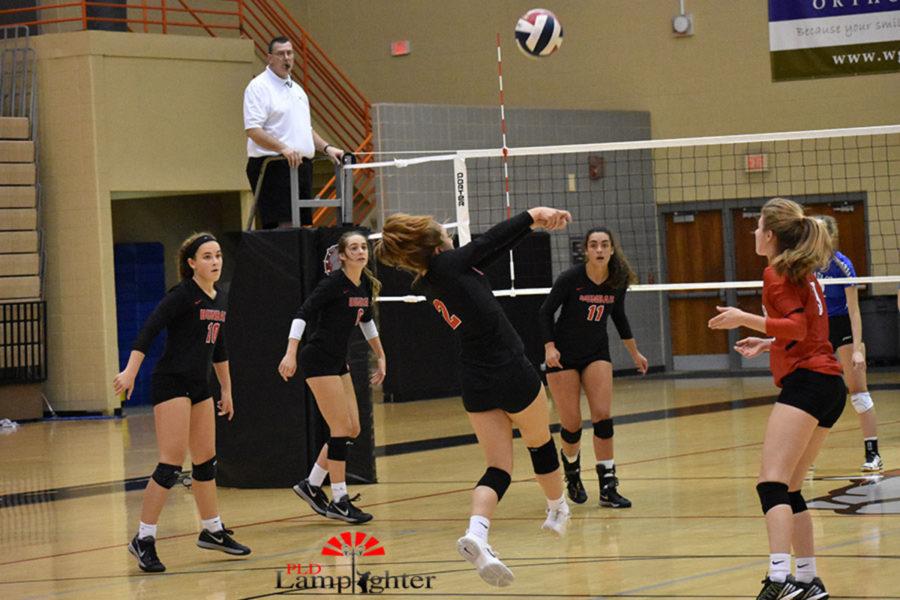Sophomore Lauren Spanyer digs a high ball for Dunbar.