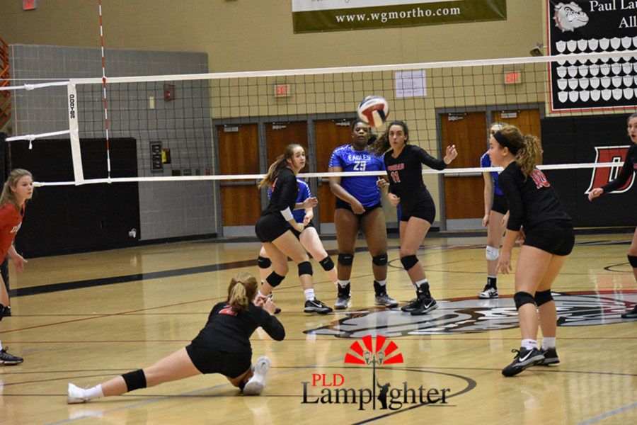 #2 Lauren Spanyer dives and digs a ball for the bulldogs.