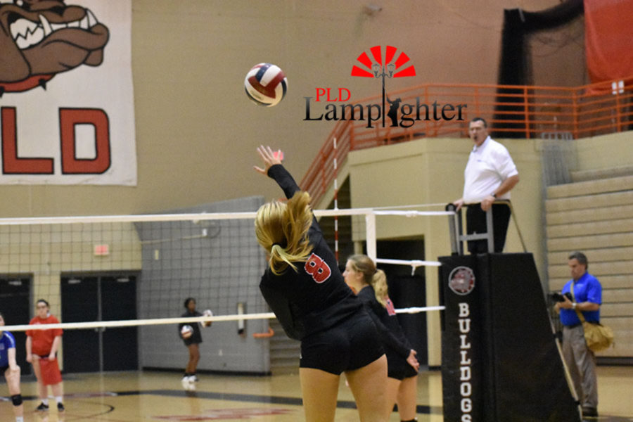 #8 Sophomore Olivia Stotz is aggressive from the service line for Dunbar.