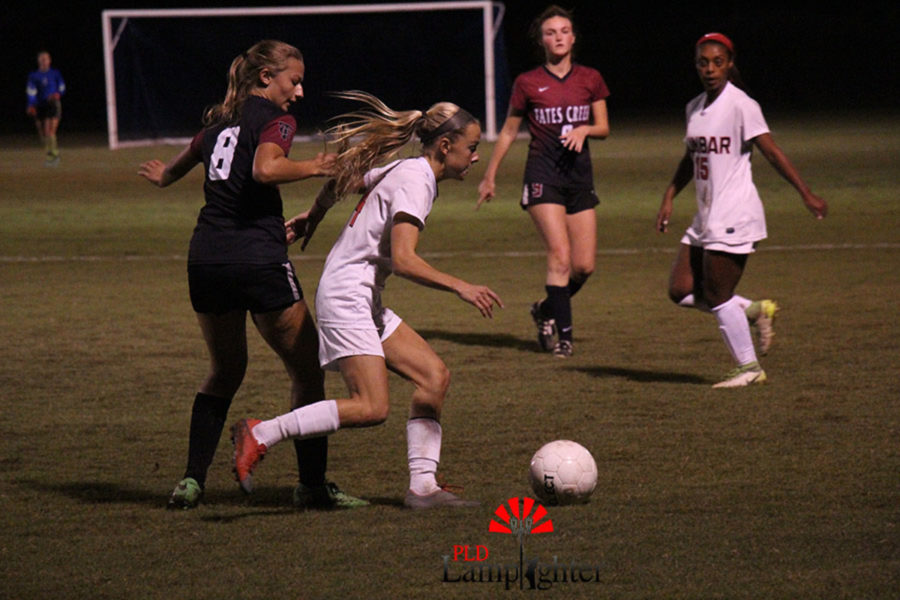 #4 Junior Audrey Rawls moves the ball down the field.
