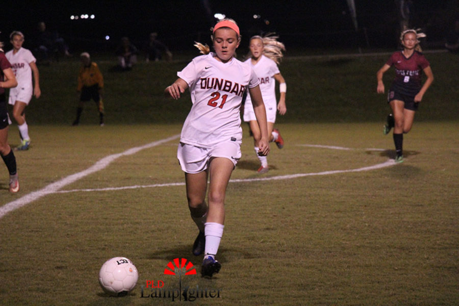 #21 Sophomore Teagan Garrison in control of the ball.