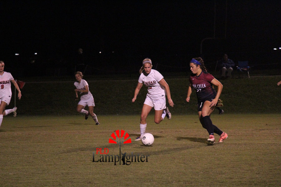 #3 Senior Callahan Stokley dribbles the ball down the field.