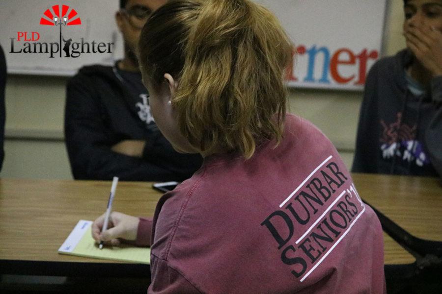 Senior Mackenzie McConnell jotting down ideas for Student Voice.