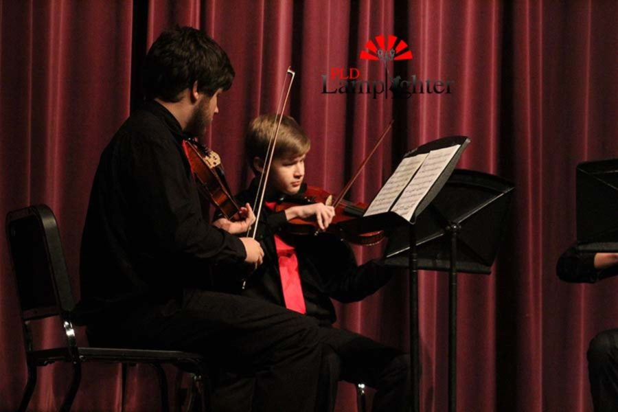 Camden Ross and Jared Taylor performing the viola together.