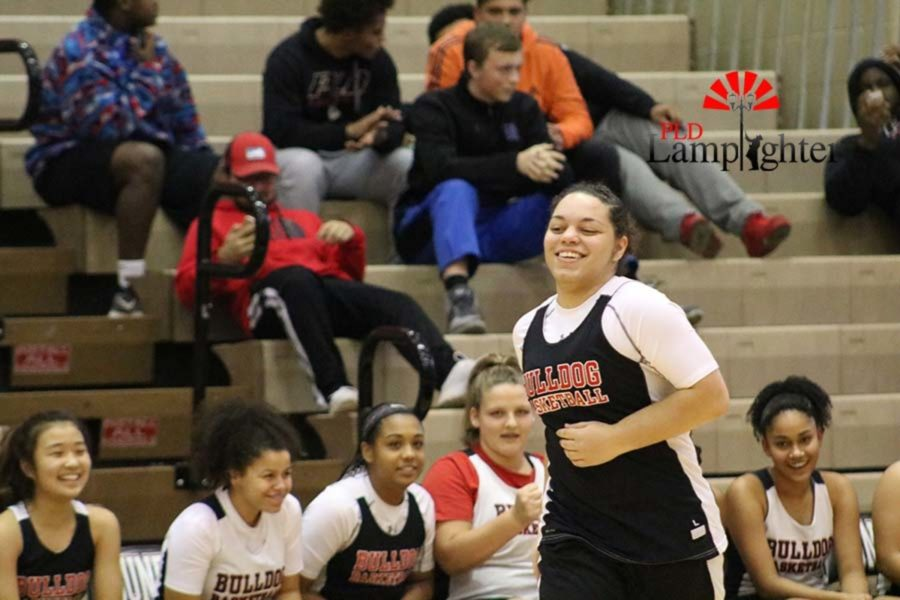 Junior Jailyn Ginter smiles as she runs down the court.