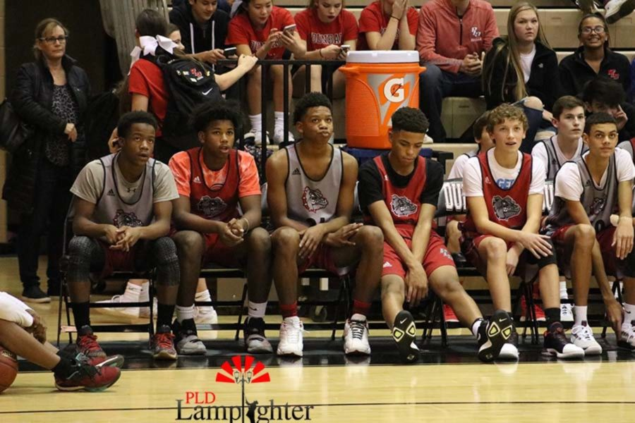 Dunbar players watch their team on the sidelines.