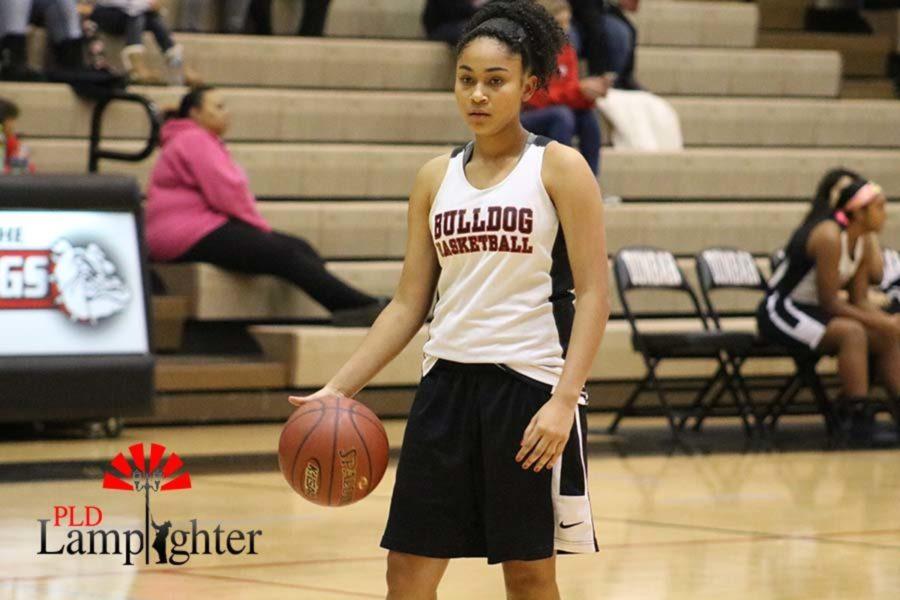 Freshman Lourdes Kinnard dribbles the ball.