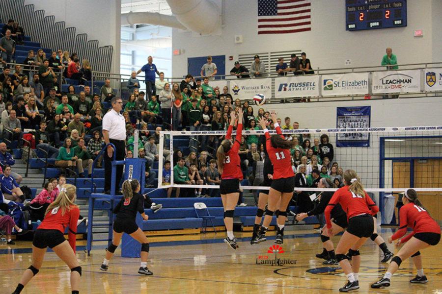#13 Senior Virginia Smith and #11 Senior Savannah Dudek jump to block the ball.
