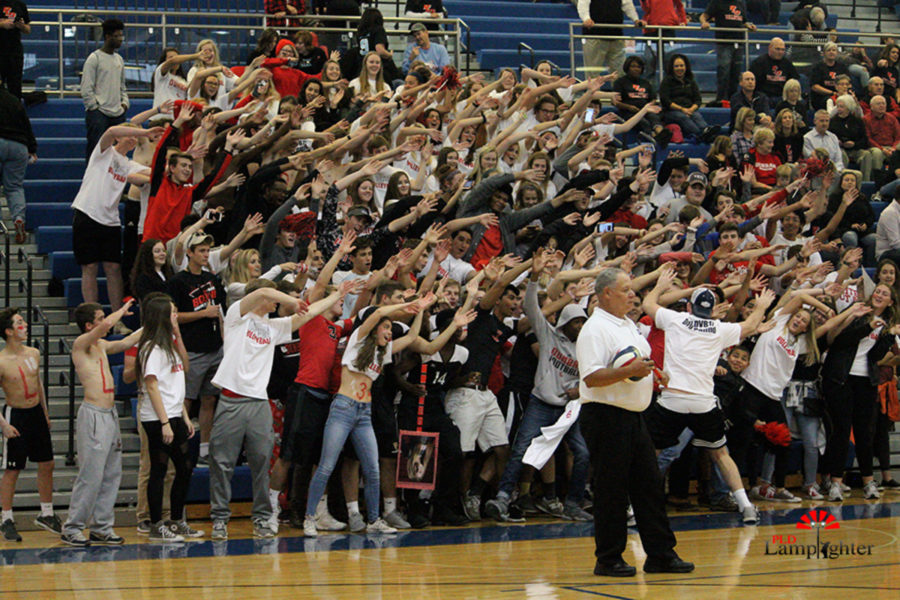 Student section performs chants to rally up the crowd during a timeout.