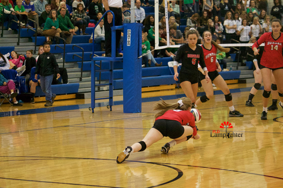 #3 Freshman Caroline Cole hits the floor for a dig.