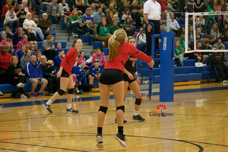 #8 Sophomore Olivia Stotz backs up for the pass.