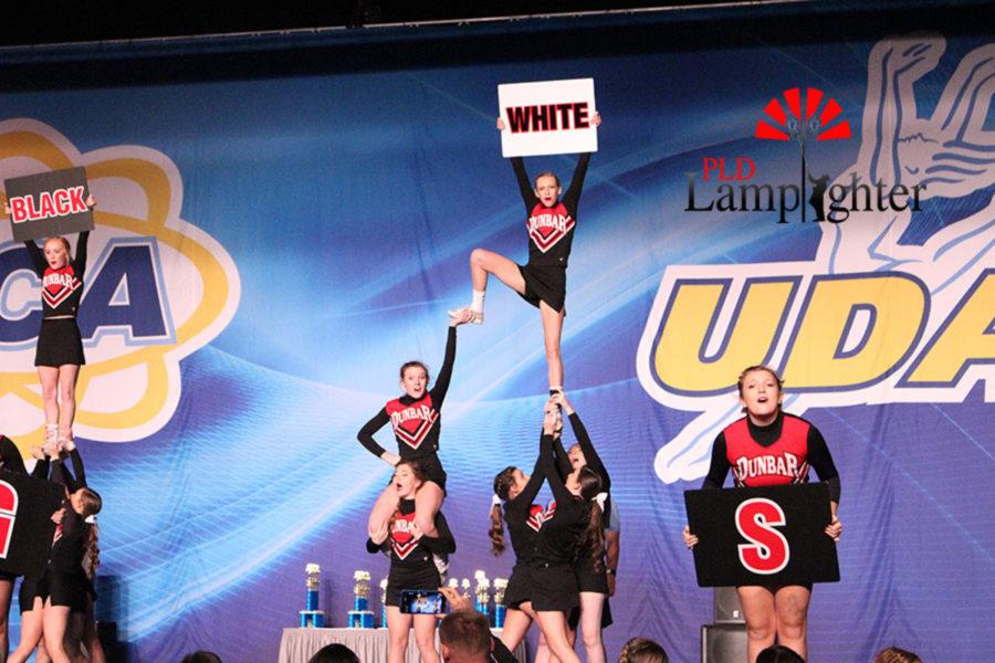 Dunbar cheerleaders chant Dunbar colors during a stunt.