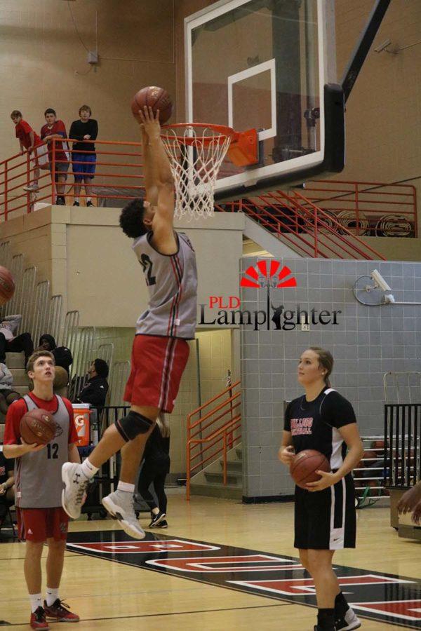 #22 Junior Michael Corio dunks the ball.