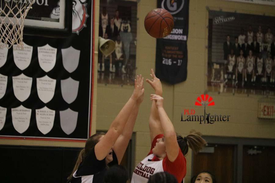 Freshman Hailey Gadd puts up a shot under defensive pressure from sophomore Caroline Dudek.