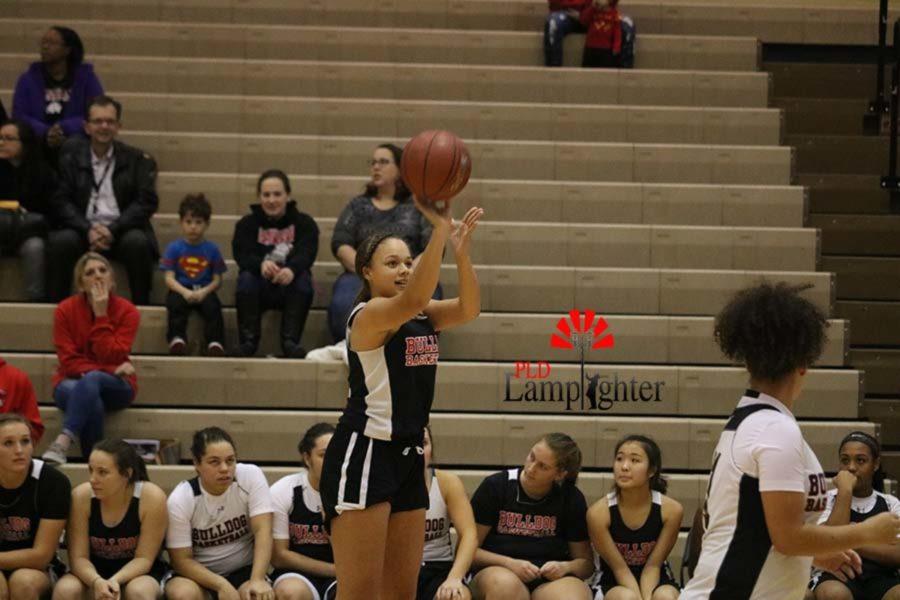 Freshman Elise O'Nan shoots a 3-pointer.