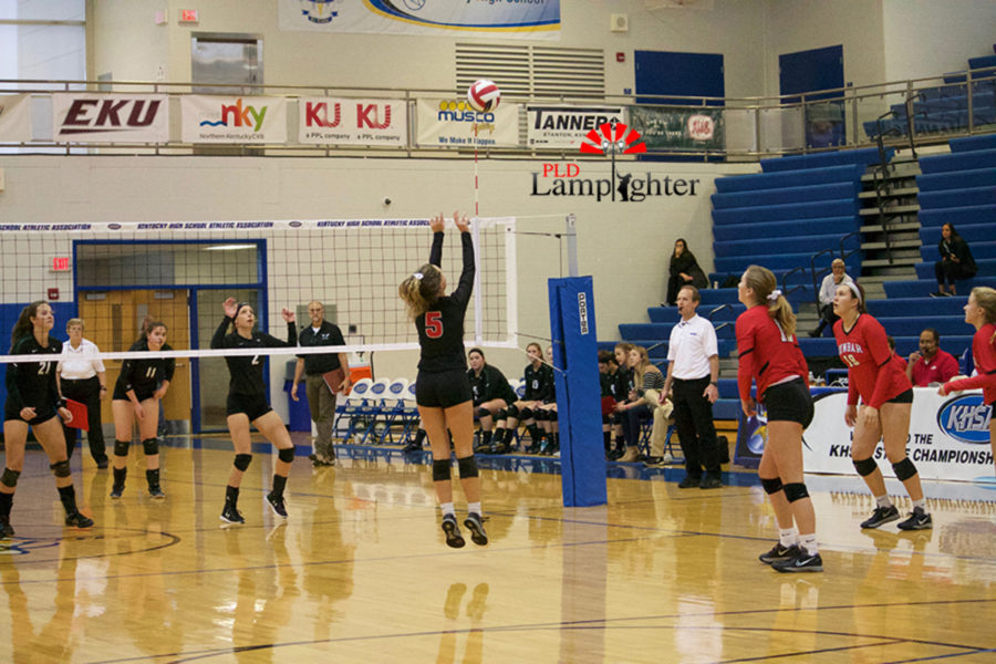 #5 Senior Allie Chapman sets up a hitter from back row.