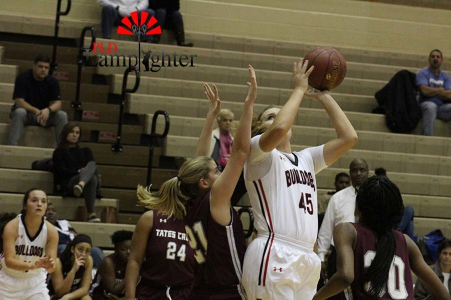 #45 Senior Brooke Hill gets past the defense for a lay up.