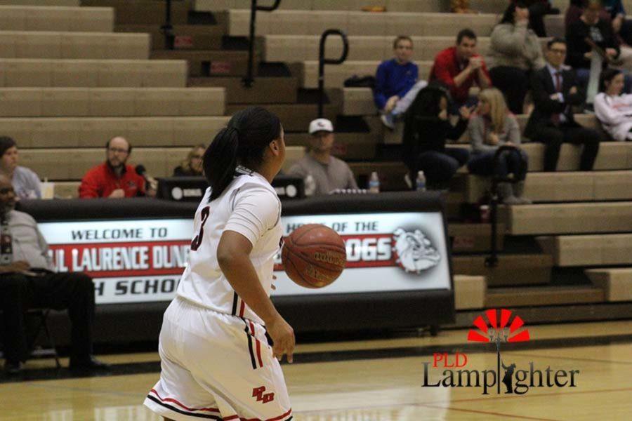#3 Freshman Tanaya Cecil dribbles the ball down the court.