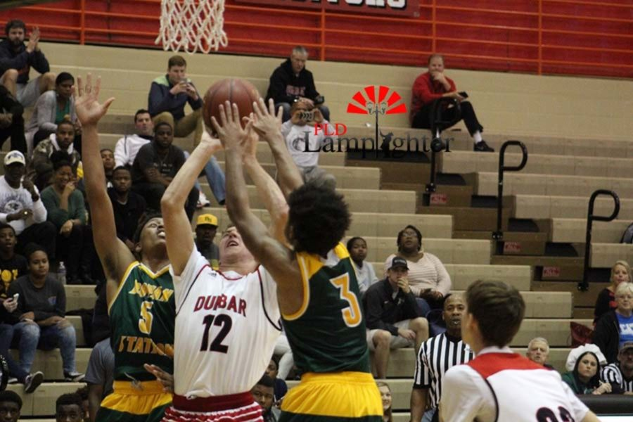 #12 Junior Jared Gadd going up for a layup.