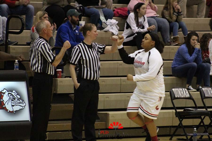 Anaiyah Cotton fist bumping the referees before the start of the game.